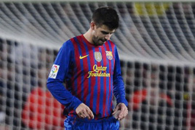 Real form surprises Barca's Pique