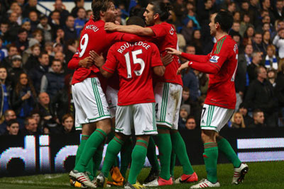 Swansea City players celebrating a goal