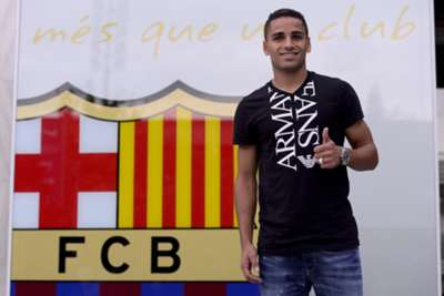 Douglas completes Barca switch
