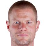 J. Mikkelsen
